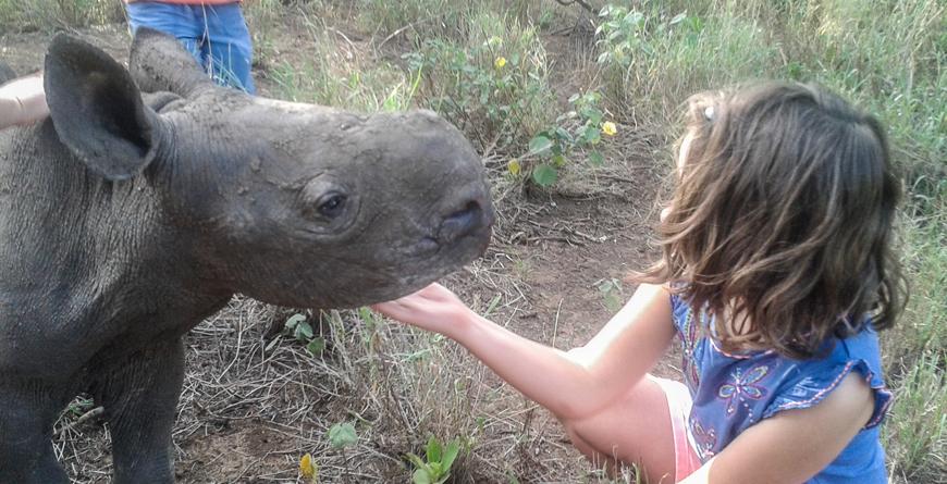 Girl with baby rhino