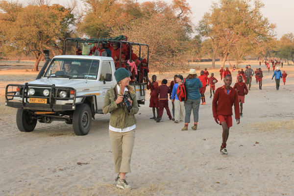 11 Imvelo Safari Lodges Camelthorn Walking to school from Ngunyana Grade 1s ride the car