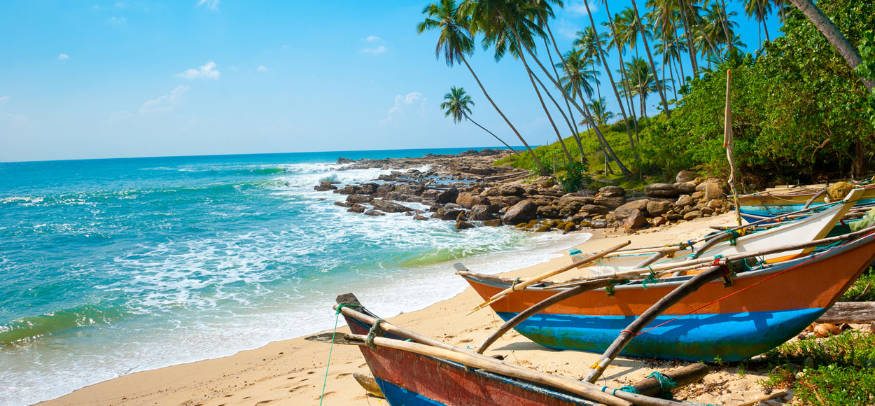 Boats on the beach, courtesy Shutterstock