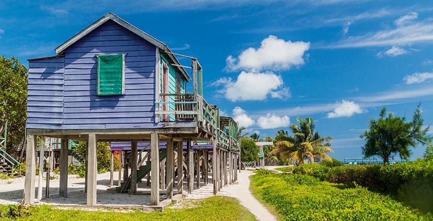 Houses on Stilts Caulker Caye Credit Shutterstock